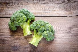 picture of cruciferous  - Broccoli Florets On The Wooden Table Close Up - JPG