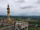 Buddha statue standing on a mountain