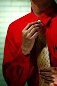 Man wearing red long sleeve shirt and yellow necktie