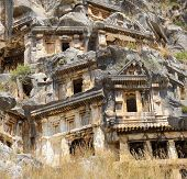 image of rock carving  - Lycian rock cut tombs carved into the hillside of Myra Turkey - JPG