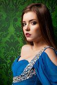 Portrait Og Beautiful Woman On Vintage Background