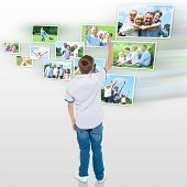 Young Boy Choosing His Outdoor Photo To Share