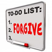 Forgive word written on a to do list on dry erase board to illustrate the act of absolving, excusing or forgetting a wrongdoing