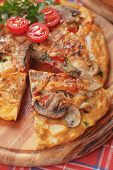 Spanish tortilla omelet with eggs, potato, mushrooms and vegetable
