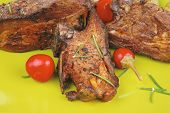 savory plate: grilled ribs over green with peppers and green salad