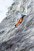 Woman Is Climbing On A Stone Wall