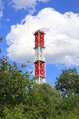 stock photo of chp  - High industrial chimney against the blue sky - JPG