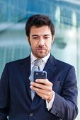 Handsome business man using a mobile phone
