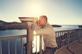 tourist looking through telescope