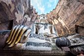 image of chums  - Phra Atchana, the big image of Buddha, in Sri Chum temple, the Sukhothai Historic Park, Thailand