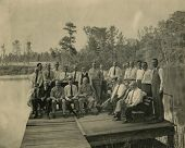 CANADA - CIRCA 1940s: Vintage photo shows colleagues of  business team on rustic picnic..