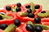 stock photo of marinade  - Black olives marinaded cucumbers and cut paprika on the plate - JPG