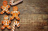 stock photo of ginger bread  - ginger biscuit on a dark wood background - JPG