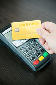 Man Pays A Gold Card In Payment Terminal
