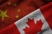 picture of trade  - 3D rendering of the flags of China and Canada on woven fabric texture - JPG
