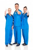 group of cheerful healthcare workers thumbs up