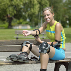 image of inline skating  - young woman with smile inline skater in Prague - JPG