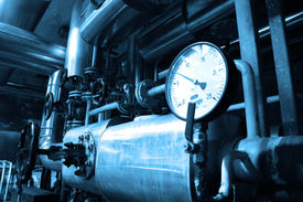 stock photo of pipeline  - grunge oil and gas pipelines in a blue toning Industrial zone - JPG