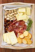 pic of cheese platter  - cheese platter on the brown wooden background - JPG