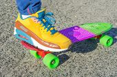 foto of skateboarding  - Leg skateboarder on the bright colorful skateboard - JPG