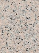 stock photo of slab  - smooth bright beautiful mottled granite stone with small patches of gray and pink in the slab - JPG
