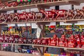 image of carabao  - wooden crafted figurines in a souvenir shop - JPG