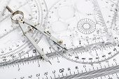 foto of protractor  - pair of compasses on transparent rulers and protractors - JPG