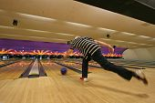 picture of bowling ball  - A man who has just thrown his bowling ball - JPG