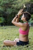 pic of mudra  - Woman meditating outdoors with hands in anjali mudra and mala beads - JPG