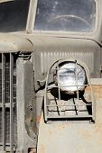 picture of headlight  - Closeup of old green military truck with headlight in bars - JPG