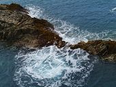 stock photo of breaker  - The rocks and the wave breakers of the Atlantic ocean at Puerto de la Pena on the island Fuerteventura one of the Canary islands belonging to Spain - JPG