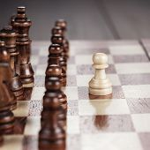 stock photo of chessboard  - chess leadership concept on the wooden chessboard - JPG