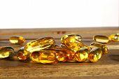picture of prophylactic  - few dietary supplement pills on wooden desk - JPG