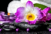stock photo of calla  - spa background of orchid dendrobium green leaf Calla lily purple candles towels and beads on zen stones with drops closeup - JPG