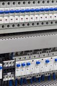 stock photo of contactor  - Various electrical components in industrial technological process - JPG