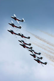 pic of snowbird  - Snowbirds full formation flying synchronously while leaving trails of smoke behind - JPG