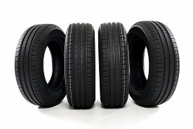 picture of four-wheel  - Four summer new car tires ready for season - JPG