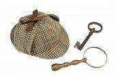 pic of sherlock  - Sherlock Holmes Deerstalker Cap Vintage Magnifying Glass And Old Key Isolated On White Background - JPG
