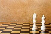 foto of chessboard  - One chess king dominating another on the chessboard - JPG