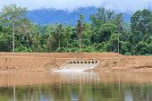 foto of dam  - flowing water released from the open sluice gates of a dam - JPG