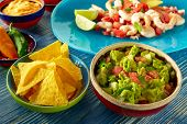 stock photo of nachos  - Guacamole mexican food with shrimp ceviche nachos and chili peppers - JPG