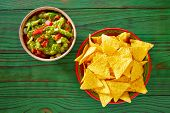 picture of nachos  - Guacamole with avocado tomatoes and nachos mexican food - JPG