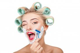 picture of razor  - Cheerful woman has having cream over her face - JPG