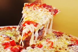 stock photo of crust  - fresh baked pizza with pepperoni olives and peppers - JPG