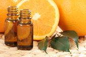 bottles of essential oils and some resh oranges
