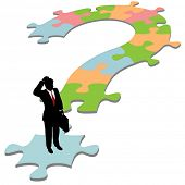 A business man on question mark jigsaw puzzle searches for a solution.