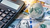 Global Business And Economy. World Globe Crystal Glass And Calculator On Various International Money poster