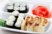 Sushi Roll Set In A White Box. A Lot Of Different Sushi With Wasabi And Ginger. Ready Order In A Sus poster