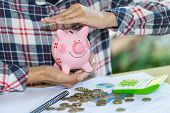 Piggy Bank Protected By Hands, Savings Protection. poster