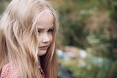 Unbinding My Hair. Little Girl Wear Long Hair. Little Girl With Blond Hair. Happy Little Child With  poster